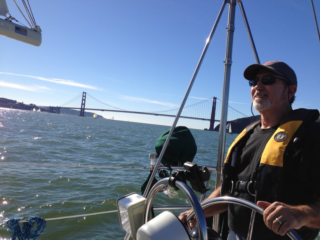 Rick at the helm with the Golden Gate Bridge in the background