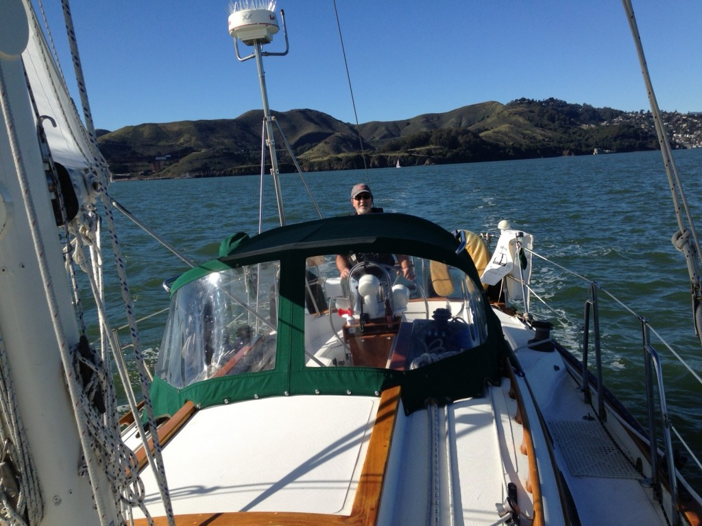 From the bow, with Rick at helm and Angel Island in the background