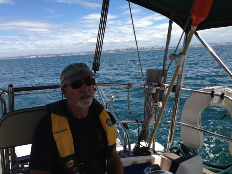 Rick at the Helm of Adventure, with San Diego in the background