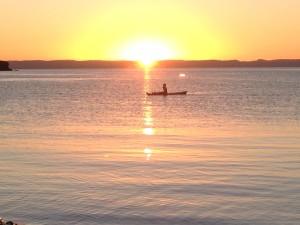 Lone kayaker at Playa Pichilingue as the sun sets