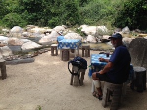 Rick at the cafe seating area at riverside, off the path to the distant waterfall