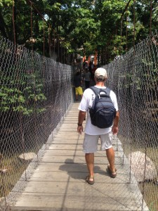 Rick in Old Town, Puerto Vallarta, stabilizing himself as he crosses a suspension pedestrian bridge.  It made me dizzy!