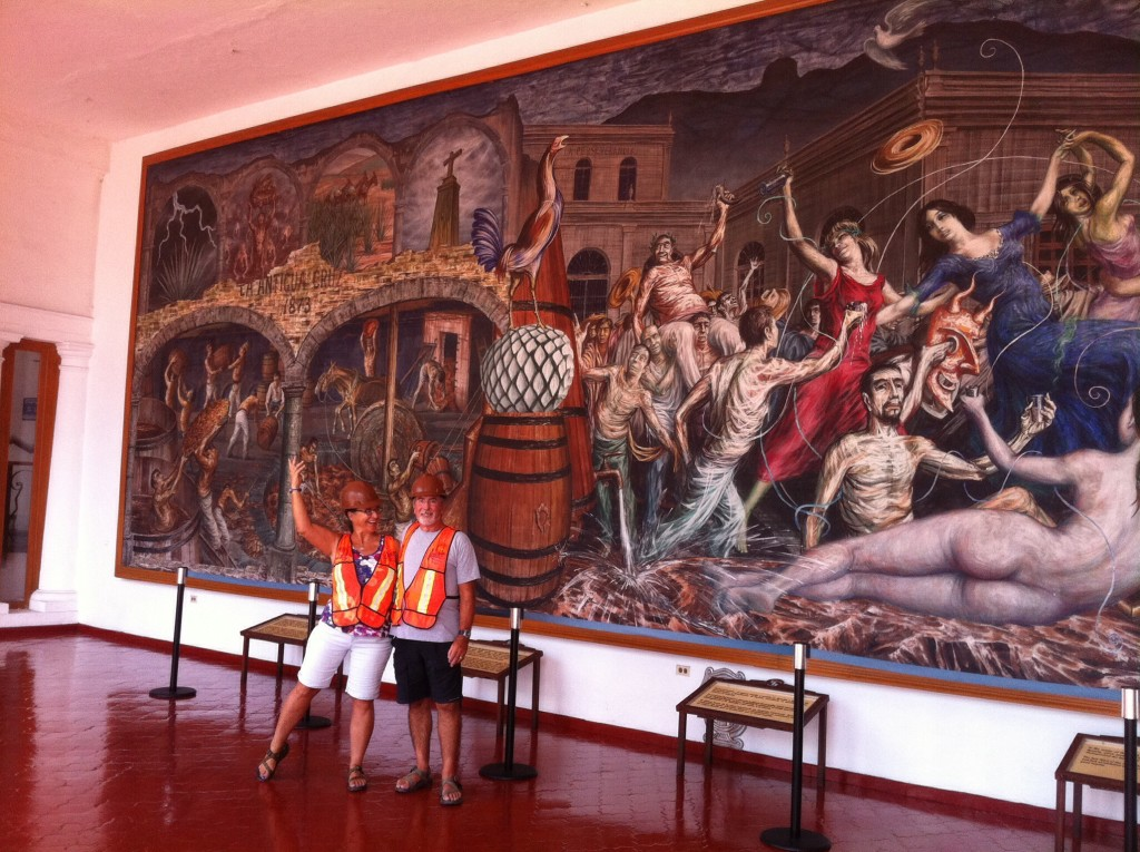 Rick and Cindy in front of the mural at the Sauza distillery. The mural depicts the Tequila party; after a few of her own, Cindy poses as the woman in the red dress!