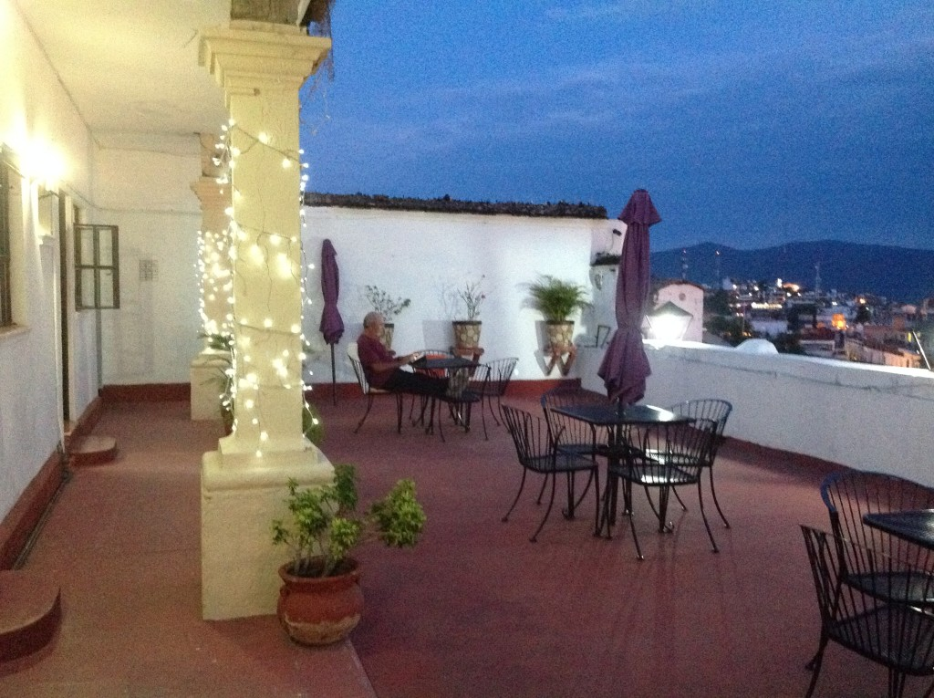 Rick enjoying a moment of Internet on the roof patio outside our room on the first night in Taxco