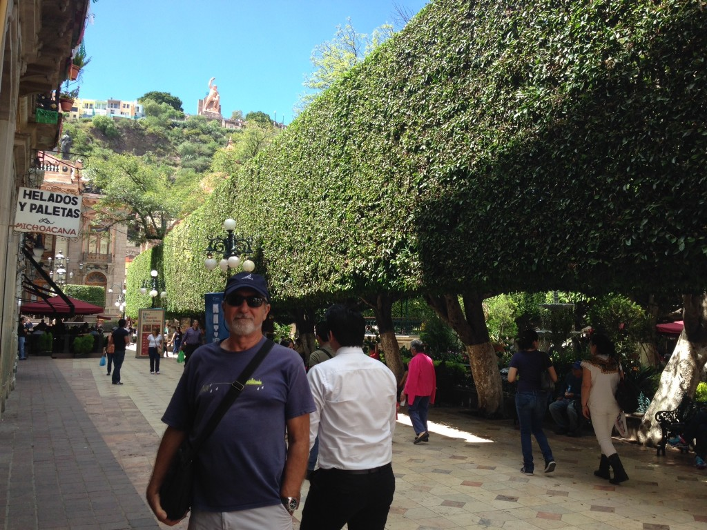 Rick alongside the main square in Guanajuato, with its perfectly coiffed laurel trees providing shade for nearly the entire square. Sidewalk cafes surround the square, serving everything from Alta Cocina Mexicana to cold beers washed down with live Mariachi songs