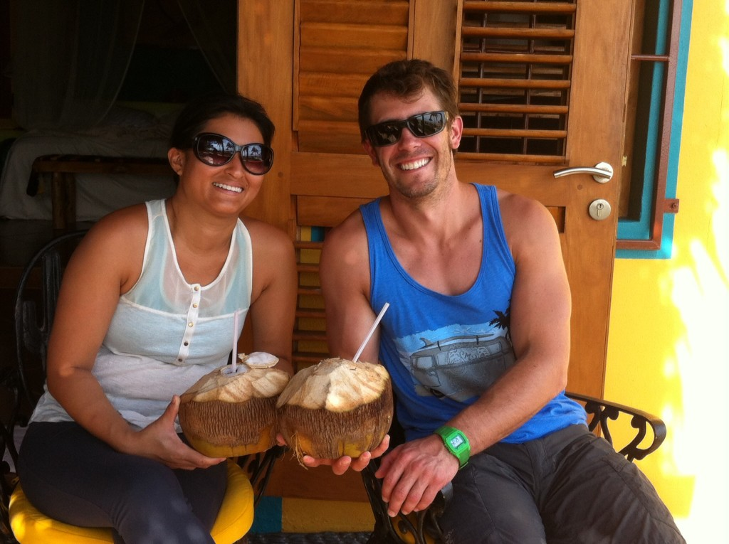 Sara and Dan with the coconuts the groundskeeper cut off the palm tree for them