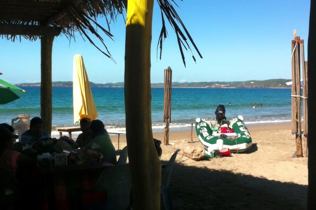 Our dinghy being guarded by an entourage of beach salespeople sitting at a local restaurant in La Manzanilla