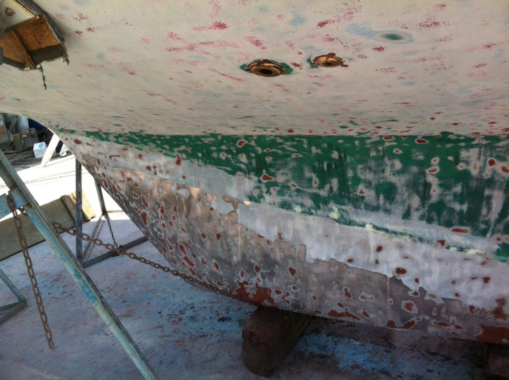 They stripped the bottom down to remove layers and layers of 27 years of bottom paint, and also prepped the hull gel coat for new paint